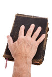 Hand on a Bible Stock Images