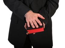 Hand On Bible. Man in suit closeup of hands holding bible Royalty Free Stock Photography