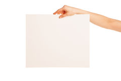In hand big blank sheet of white paper shown down Royalty Free Stock Photo
