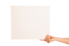 In hand a big blank sheet of white paper shown up Royalty Free Stock Photography