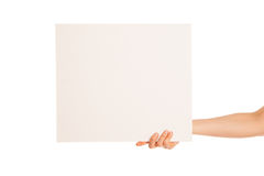 In hand a big blank sheet of white paper shown up Royalty Free Stock Image