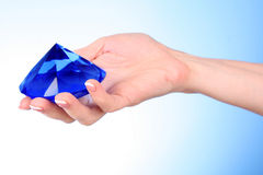 hand with big blue crystal Stock Image