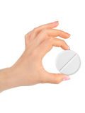 Hand with big pill Royalty Free Stock Photos