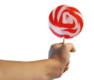 Hand with big red/white Christmas lollipop Stock Photo