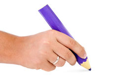 Hand with big violet wooden pencil Royalty Free Stock Image