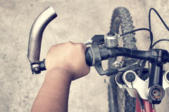 Hand with bike Stock Images