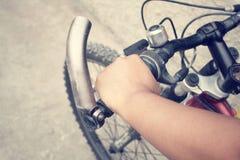 Hand with bike Stock Photo