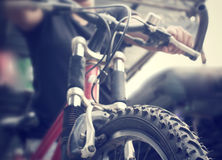Hand with bike Stock Photography