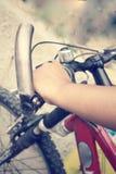 Hand with bike Stock Photos