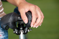 Hand on bike saddle Royalty Free Stock Photography