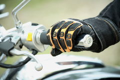 Hand biker. Biker hand rests on the steering wheel motorcycle Stock Photography
