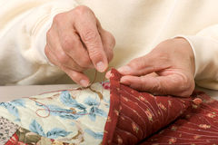 Hand binding quilt Stock Photography