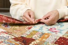 Hand binding quilt Stock Photos