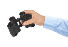 Hand with binoculars Stock Photography