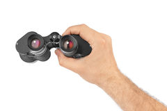 Hand with binoculars Royalty Free Stock Images