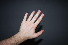 Hand on a black background Stock Image