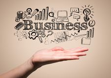 Hand with black business doodles against cream background Royalty Free Stock Image