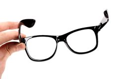 Hand with black glasses Stock Photos
