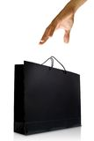Hand and black glaze paper shopping bag Stock Photography