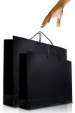 Hand and black glaze paper shopping bag Royalty Free Stock Photos