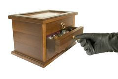 Hand in black glove opening casket with jewelry Stock Images