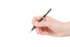 Hand with black and golden coloured pen Stock Photography