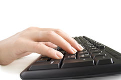 Hand on the black keyboard Royalty Free Stock Images