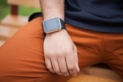 Hand of black man wearing modern smart wrist watches Stock Image