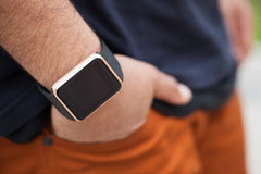Hand of black man wearing modern smart wrist watches Royalty Free Stock Image