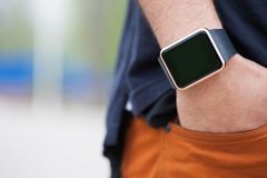 Hand of black man wearing modern smart wrist watches Stock Photography