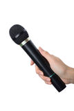Hand with black microphone isolated on white background Royalty Free Stock Photos
