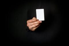 Hand through black paper Stock Image