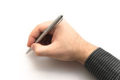 Hand with black shirt holding silver metal pen Stock Photos