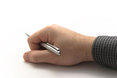 Hand with black shirt holding silver metal pen. On white background Stock Photography