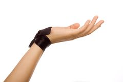 Hand with a black silk tape on a white background. Royalty Free Stock Photography