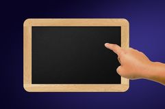 Hand and blackboard Stock Image