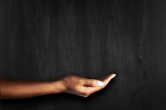 Hand on a blackboard Royalty Free Stock Photos