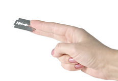 Hand with a blade Royalty Free Stock Photography