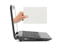 Hand with blank card and notebook Stock Image
