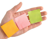 Hand with blank colorful post it notes Royalty Free Stock Images