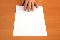 Hand and blank document. Male hand presents a blank document Royalty Free Stock Photos