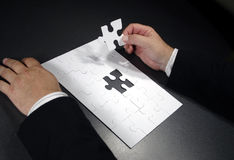 Hand with blank jigsaw Royalty Free Stock Image