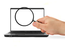 Hand with blank magnifying glass and notebook Stock Images