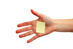 Hand with blank note Stock Images