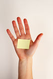 Hand with blank note Royalty Free Stock Images
