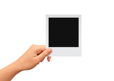 Hand with blank photo card. Hand with blank retro photo card, add your image Royalty Free Stock Photos
