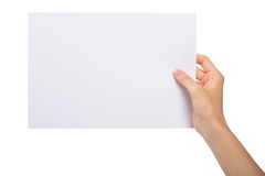 Hand with blank sheet of paper Stock Photos