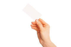 In hand blank sheet of white paper held diagonally Royalty Free Stock Image