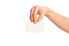 In hand a blank sheet of white paper shown down Stock Image