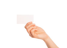 In hand a blank sheet of white paper shown up Royalty Free Stock Photos